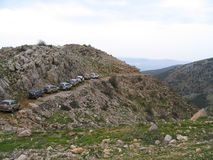 Jeeps in mountain path, Israel. A row of jeeps driving in mountain terrain, Israel stock photo
