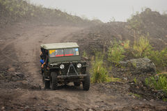 Jeeps with tourists coming back from a ride around Merapi volcan Stock Photo