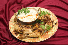 Jeera chicken and cucumber raita Royalty Free Stock Photography