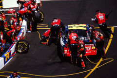 #24 Jeff Gordon Pit Stop. Jeff Gordon in the #24 Car gets tires and fuel. (2002). (Image taken from color negative royalty free stock photo