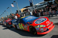 Jeff Gordons car covered on pitt lane. NASCAR cars lined up on Pitt lane. Jeff Gordon car is one of the first cars in the line Royalty Free Stock Image