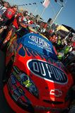 Jeff Gordons race car in pits with crowd. People all around jeff gordons race car. The NASCAR race team is uncovering the vehicle Royalty Free Stock Images