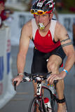 Jeff Keil Racing in the Arizona Ironman Triathlon Stock Images