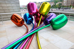 The Jeff Koons tulips in Guggenheim  Bilbao. The Jeff Koons tulips sculputure outside the Guggenheim  Museums in Bilbao, Spain, Basque Country Royalty Free Stock Image
