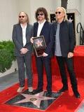 Jeff Lynne & Tom Petty & Joe Walsh royaltyfria bilder