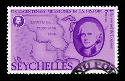Jefferson and map of Louisiana. Seychelles-CIRCA 1976: A stamp printed in USA shows Jefferson and map of Louisiana Purchase, series american revolution, circa royalty free stock photos