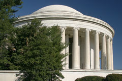 Jefferson Memorial. Against a blue sky with trees in foreground Stock Photos
