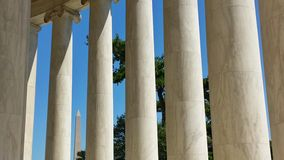 Jefferson Memorial Columns with Washington Monument in Distance. Two Washington D.C. landmarks seen simultaneously Stock Image