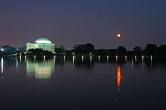 Jefferson Memorial at Dusk. With reflection in the Tidal Basin, Washington, DC, USA with full moon higher in the sky Royalty Free Stock Photography