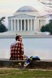 Jefferson memorial during the sunset. Tidal basin with a guy and his toy in Washington DC royalty free stock images