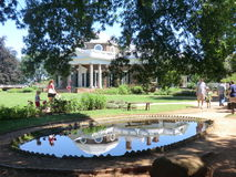 Jefferson`s Monticello Pond Reflection. Tourists visiting Jefferson`s Monticello Pond Reflection. The home of Thomas Jefferson. This reflection is in a fish Royalty Free Stock Image