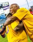 Jeffrey Osborne gives Eddie Levert, Jr. a big hug. Singer Jeffrey Osborne give O'Jay's singer Eddie Levert, Jr. a hug after singing the National Anthem prior to Stock Image