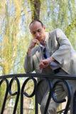 jego spojrzeń mężczyzna zegarka potomstwa Fotografia Stock