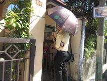 Jehovah's Witness Preaching Door to Door. A Jehovah's Witness engaged in the house ministry in a provincial area outside of Metro Manila in the Philippines Stock Photos