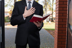 Jehovah's witness standing at the door Royalty Free Stock Photos