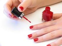 jej malowanie paznokci Zdjęcie Stock