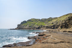 Jeju-делают, Корея - 11-ое апреля 2015: Взгляд побережья Yongmeori внутри Стоковое фото RF