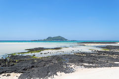Jeju Do beach. Beach at Jeju Do with small island view Royalty Free Stock Images