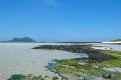 Jeju Do beach. Beach at Jeju Do with small island view Stock Photo