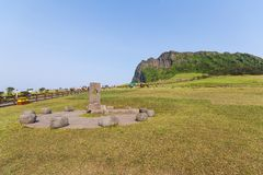JEJU ISLAND. KOREA - MAY 29, 2012: Seongsan Ilchulbong Peak rose from under the sea in a volcanic eruption over 100,000 years ago Royalty Free Stock Photography