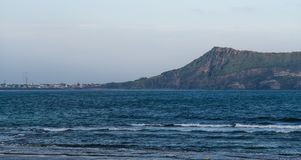 JEJU ISLAND, KOREA:View of Seongsan Ilchulbong Volcanic Cone from the town at the foothill. stock image