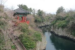 Traditional Pagoda Overlooking the river in Jeju, Korea. Royalty Free Stock Photography
