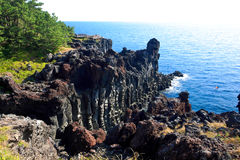Jeju Volcanic Island. Volcanic rock joint rising out of the ocean Stock Image