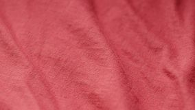 Jejua a bandeja vertical disparada de uma matéria têxtil vermelha do poliéster e do algodão filme