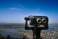 Jejudo the beauty. The telescope represents the vision of the management to foresee things faraway or see things closer Royalty Free Stock Image