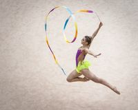 Free Jelgava, Latvia - April 8, 2018: The Rhythmic Gymnastics Latvian Championship In Jelgava. Jump. Heart Ribbon Sculpture. Stock Photo - 114460800