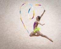 Jelgava, Latvia - April 8, 2018: The Rhythmic Gymnastics Latvian Championship in Jelgava. Jump. Heart ribbon sculpture. stock photo