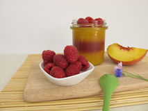 Jelled smoothie as layered dessert peach melba Royalty Free Stock Photo