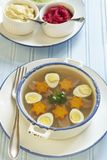 Jellied with beef tongue, carrot and quail eggs Stock Photo