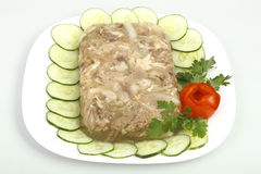Jellied chicken. Decorated with cucumber and rose with tomato Stock Image