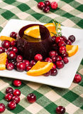 Jellied cranberry sauce with orange wedges and rosemary Royalty Free Stock Images