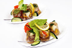 Jellied pork meat. And vegetables garnished with lettuce, cucumber and lemon Stock Photos