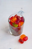 Jellies in a glass on table from above. Selective focus Stock Image