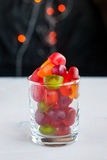 Jellies in a glass on table with garland lights. Selective focus Royalty Free Stock Photography