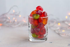 Jellies in a glass on table with garland lights. Selective focus Stock Images