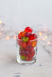 Jellies in a glass on table with garland lights. Selective focus Royalty Free Stock Photo