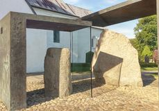 Jellinge Stones, Denmark. JELLING, DENMARK – Harald Bluetooth's big Rune Stone and King Gorm's small Rune Stone. The Jelling Monuments are a UNESCO World royalty free stock image