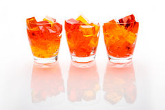 Jello In Glassed. Cubes of straberry and orange jello in glasses Stock Images