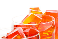 Jello In Glassed. Cubes of straberry and orange jello in glasses (shallow deph of field Royalty Free Stock Photography
