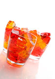 Jello In Glassed. Cubes of straberry and orange jello in glasses Royalty Free Stock Images