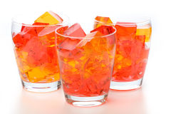 Jello In Glasses. Cubes of straberry and orange jello in glasses Stock Images