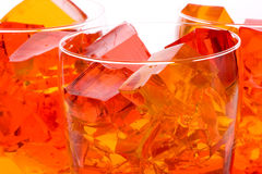 Jello In Glasses. Cubes of straberry and orange jello in glasses Stock Photo
