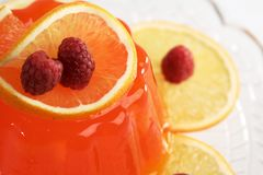 Jello pudding dessert. Orange gelatin, short focus royalty free stock photos