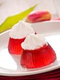 Jello rojo con crema Imagen de archivo libre de regalías