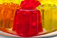 Jelly. Colored fruit jelly on a glass dish stock image