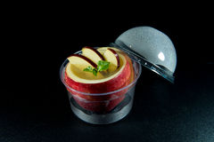 Jelly add in apple decorate with a slice of apple. Stock Image